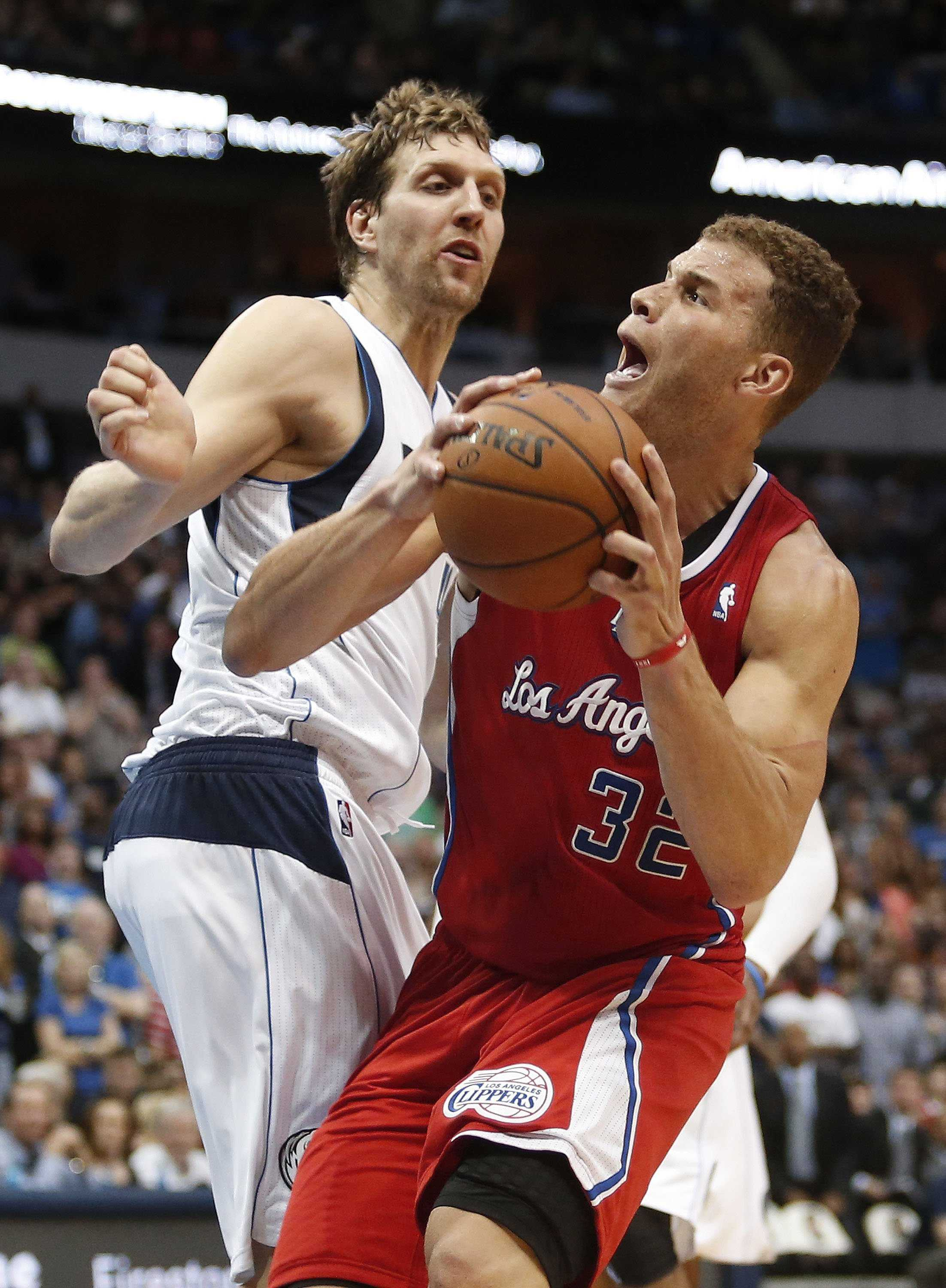 The Los Angeles Clippers' Blake Griffin (32) looks for the net as the Dallas Mavericks' Dirk Nowitzki defends in the fourth quarter at the American Airlines Center in Dallas on Thursday, March 27, 2014. The Clippers won, 109-103. (Paul Moseley/Fort Worth Star-Telegram/MCT)