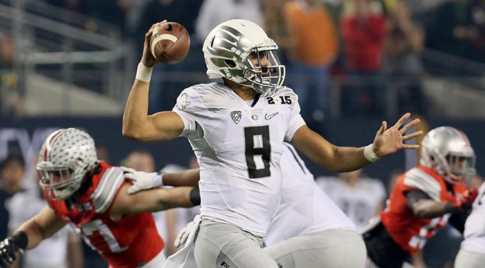 Oregon quarterback Marcus Mariota drops back to pass during the first quarter of the CFP National Championship on Monday, Jan. 12, 2015, at AT&T Stadium in Arlington, Texas. (Bob DeMay/Akron Beacon Journal/TNS)