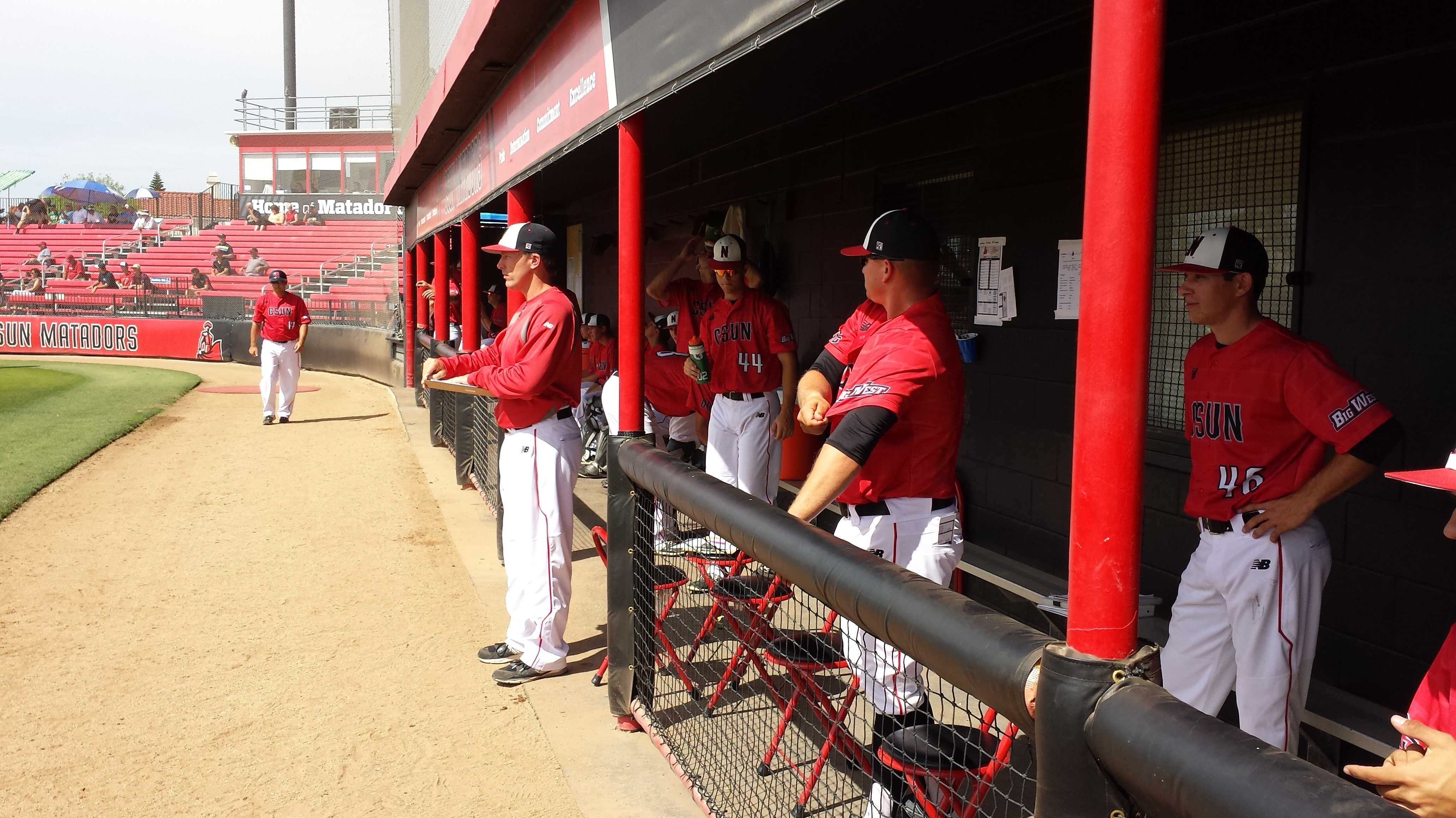 CSUN Head Coach Greg Moore looking on, as his team begins to play the final game in their three day series versus George Washington at Matador Field. Photo credit: Jordan Ball