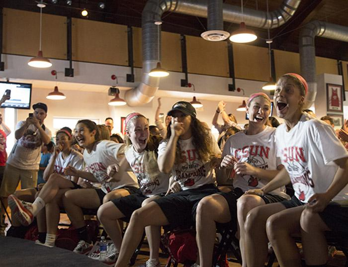 The women's basketball team reacts after learning they were selected as a No. 13 seed in the Oklahoma City Region bracket, and will face the No. 4 Stanford Cardinals in the first round of the Women's 2015 NCAA Tournmanet, on March 16 in the Pub. (Trevor Stamp / Multimedia Editor)