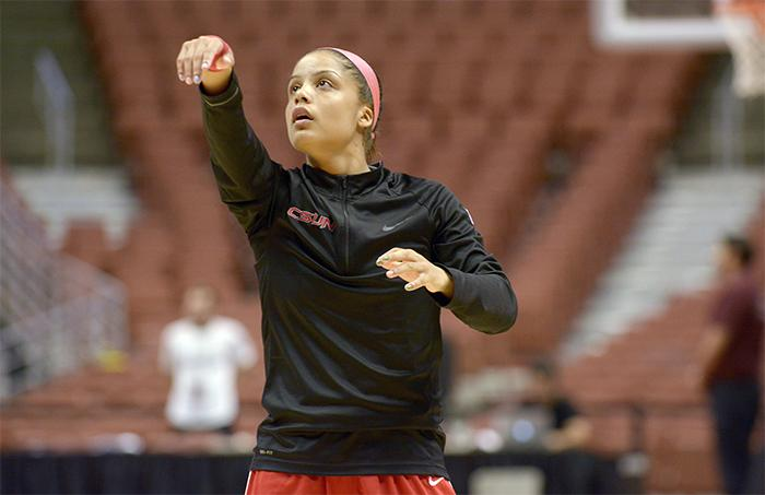 Senior Ashlee Guay warms up before the Big West Conference Championship game versus the University of Hawaii in the Honda Center on March 14. (Raul Martinez/ Staff Photographer)