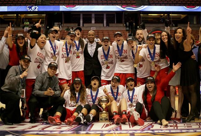 The CSUN Matadors celebrate thier back-to-back title in the Big West Conference after deefeating Hawaii by a final score of 67-60 at the Honda Center on March 14. (Raul Martinez/ Staff Photographer)