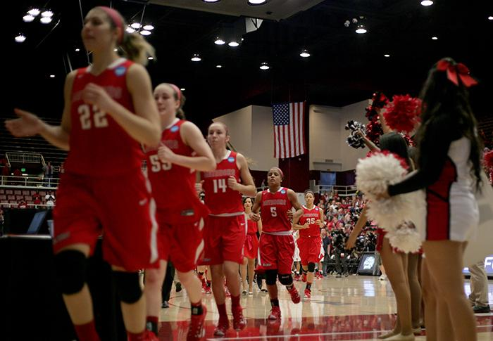 Senior Ashlee Guay and her Matadors team walk off the court for the final time after their loss to Stanford by a final score of 73-60 in the first round of the Womens NCAA tournament on March 21 in Stanford. (Raul Martinez/ Staff Photographer)