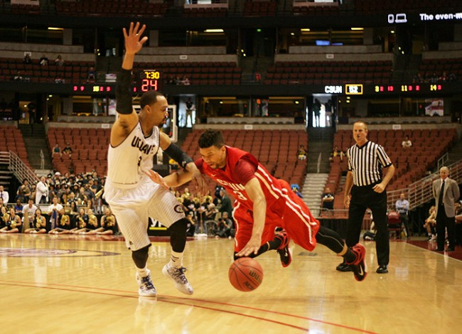 Senior Stephan Hicks tries to power past a UC Davis player in the second half of the Matadors' Big West qurater final game on March 12. The Matadors fell to the Aggies, 71-67. (Raul Martinez / Staff Photographer)