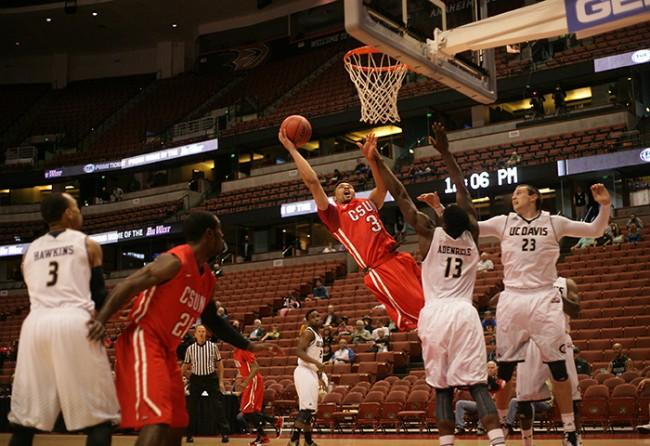 Senior Stephan Hicks fights to the basket agaist UC Davis during the first half of the Matadors qurater final game of the Big WEst Tournament on March 12 at the Honda Center. (Raul Martinez / Staff Photographer)