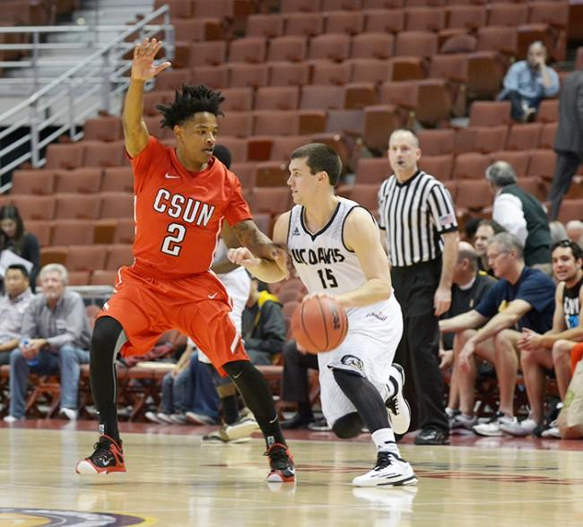 Junior Landon Drew defends against UC Davis' Tyler Les in the first half of the Matadors' Big West quarter final game on March 12. (Raul Martinez / Staff Photographer)