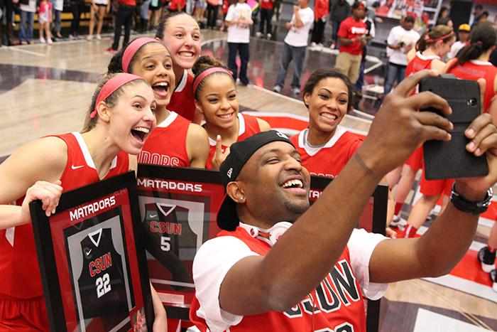 DJ Mal-Ski takes a selfie with the Women's Matadors' senior class during their final home game on March 5, 2015. (Trevor Stamp / Multimedia Editor)