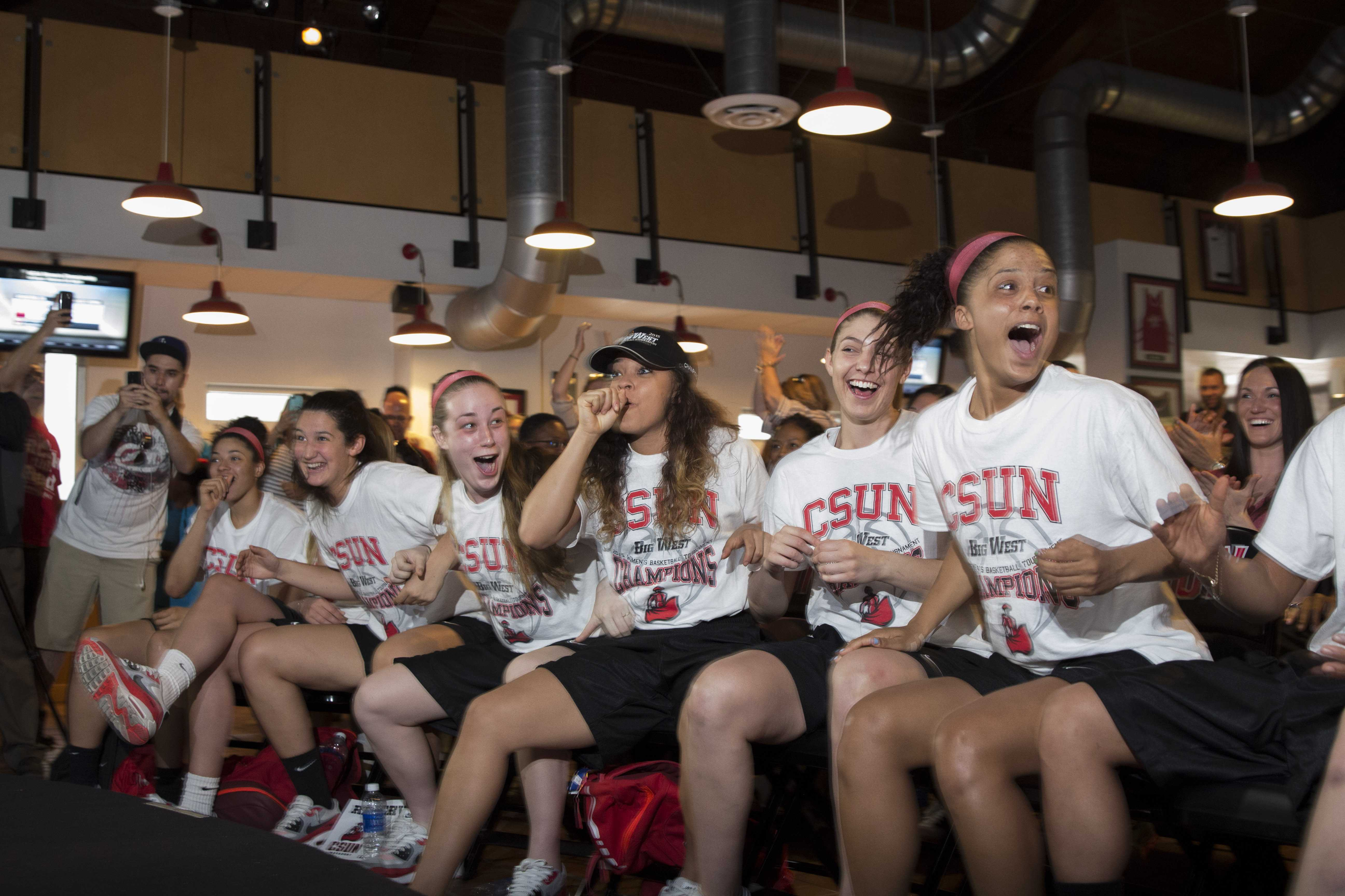 The women's basketball team reacts after learning they were selected as a No. 13 seed in the Oklahoma City Region bracket, and will face the No. 4 Stanford Cardinals in the first round of the Women's 2015 NCAA Tournmanet, on March 16, 2015 in the Pub. (Trevor Stamp / Multimedia Editor)