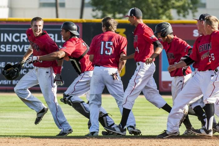 Matador+players+rush+the+field+in+excitement+to+celebrate+and+give+junior+third+baseman+William+Colantono+congratulations+for+his+walk-off+hit+in+the+13th+inning+vs+13th+ranked+UCSB.+%28Photo+credit%3A+BHEphotos%29+Photo+credit%3A+BHEphotos