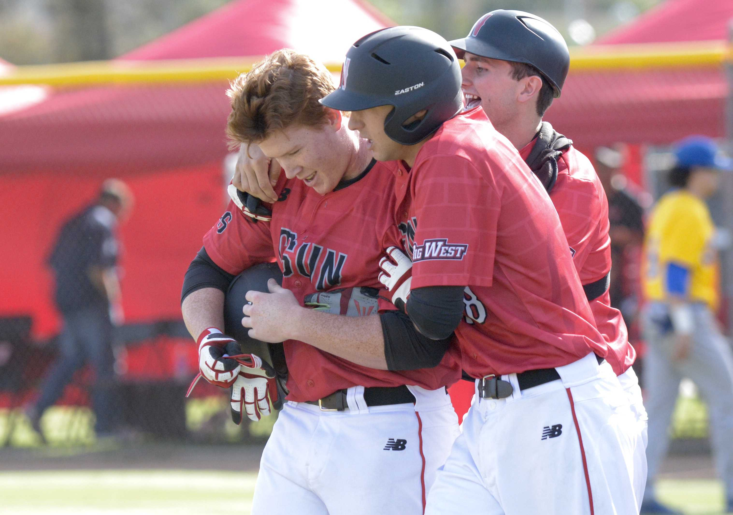 CSUN+freshman+Albee+Weiss+celebrating+with+his+teammates+as+he+gets+the+pinch-hitting+walk-off+walk+to+win+the+game+Sunday+afternoon+against+UC+Riverside.+Photo+credit%3A+Raul+Martinez