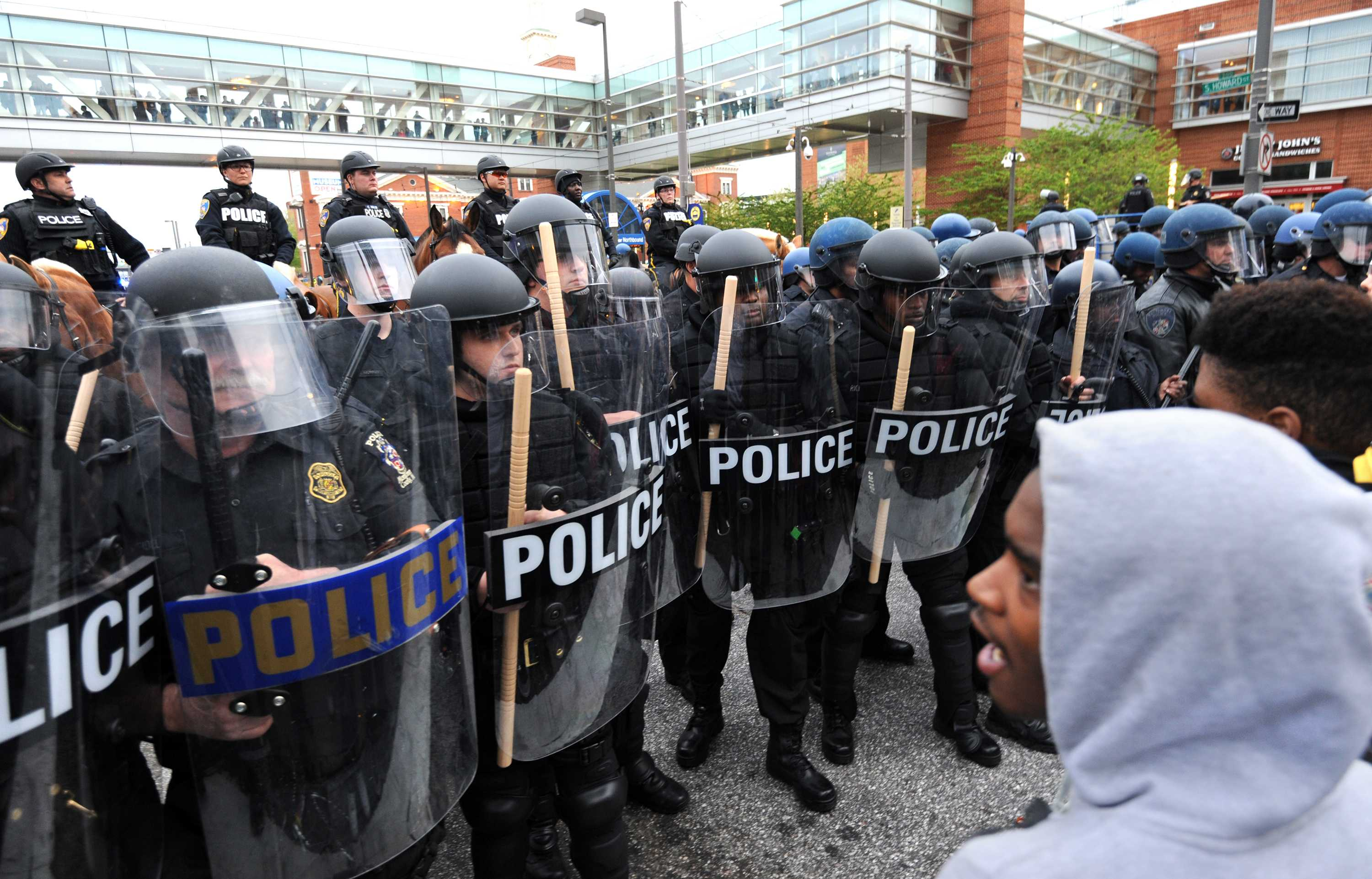 Police and protestors line up against each other across from Camden Yards in Baltimore on Saturday, April 25, 2015, as protests continue in the wake of Freddie Gray's death while in police custody. (Algerina Perna/Baltimore Sun/TNS)