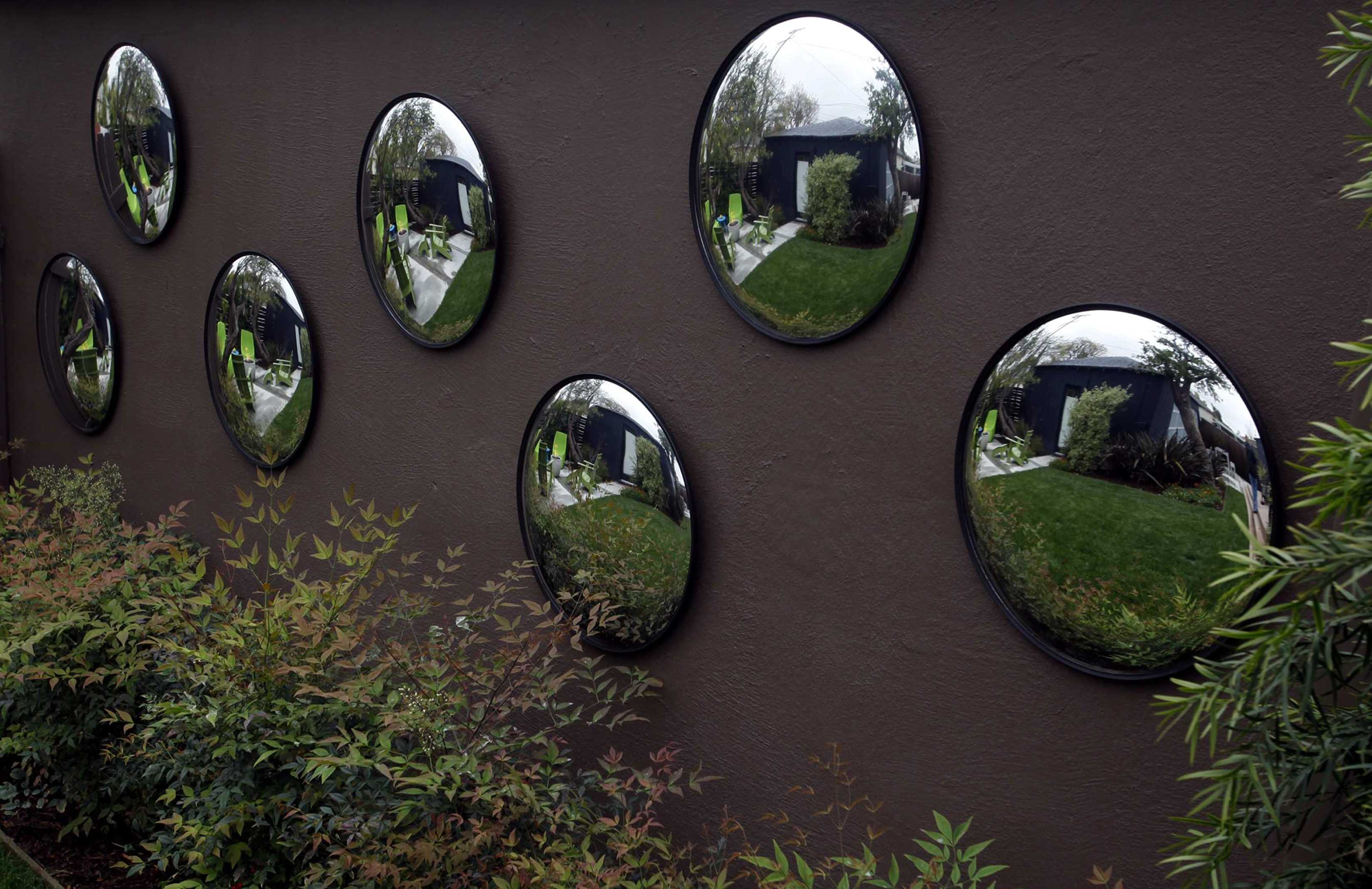 Mirrors on a wall in Jim Rash's back yard are featured March 13, 2012. Recent Oscar-winner and actor Jim Rash recently redesigned his Westside home exterior and garden spaces to create more room for entertaining. (Francine Orr/Los Angeles Times/MCT)