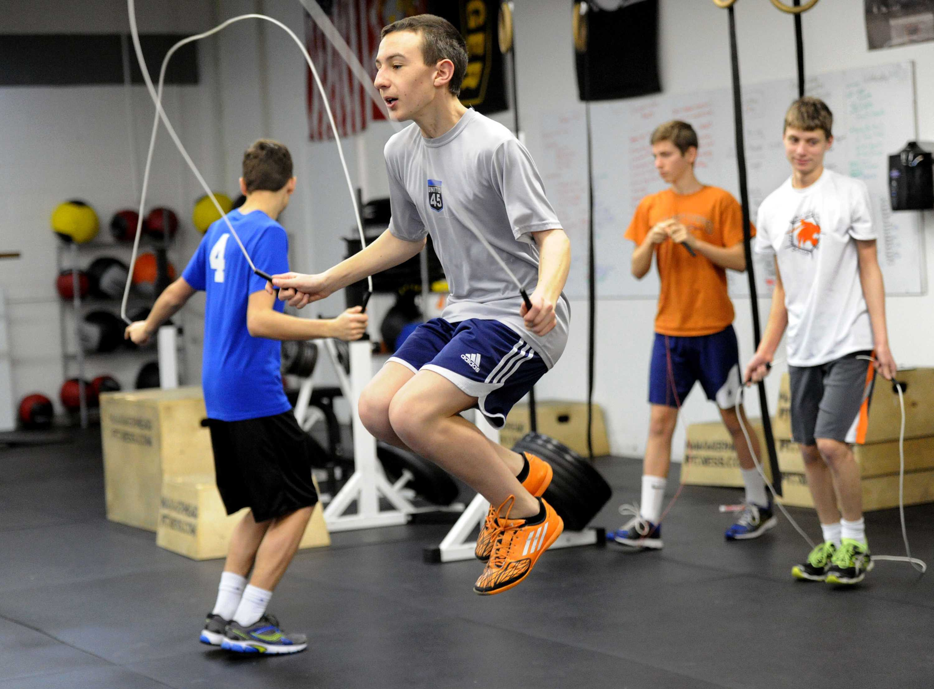 Robert Reed, 15, warms up with a jump rope before a CrossFit class for teens in Loyalhanna, Pa. (John Heller/Pittsburgh Post-Gazette/TNS)