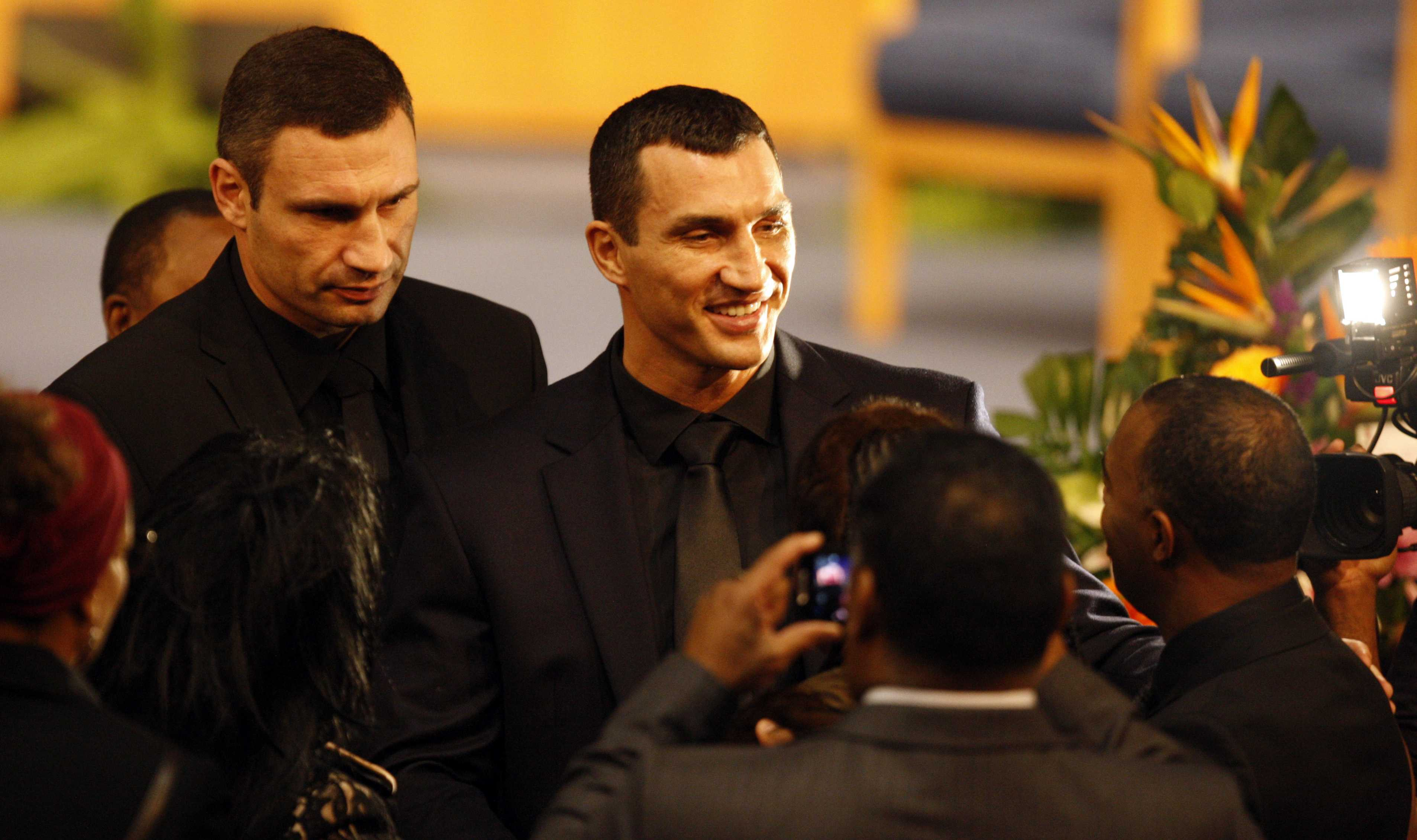 Heavyweight boxers Wladimir and Vitali Klitschko greet family members during family hour before the memorial services for Emanuel Steward Tuesday, November 13, 2012 at Greater Grace Temple in Detroit, Michigan. (Kirthmon F. Dozier/Detroit Free Press/MCT)