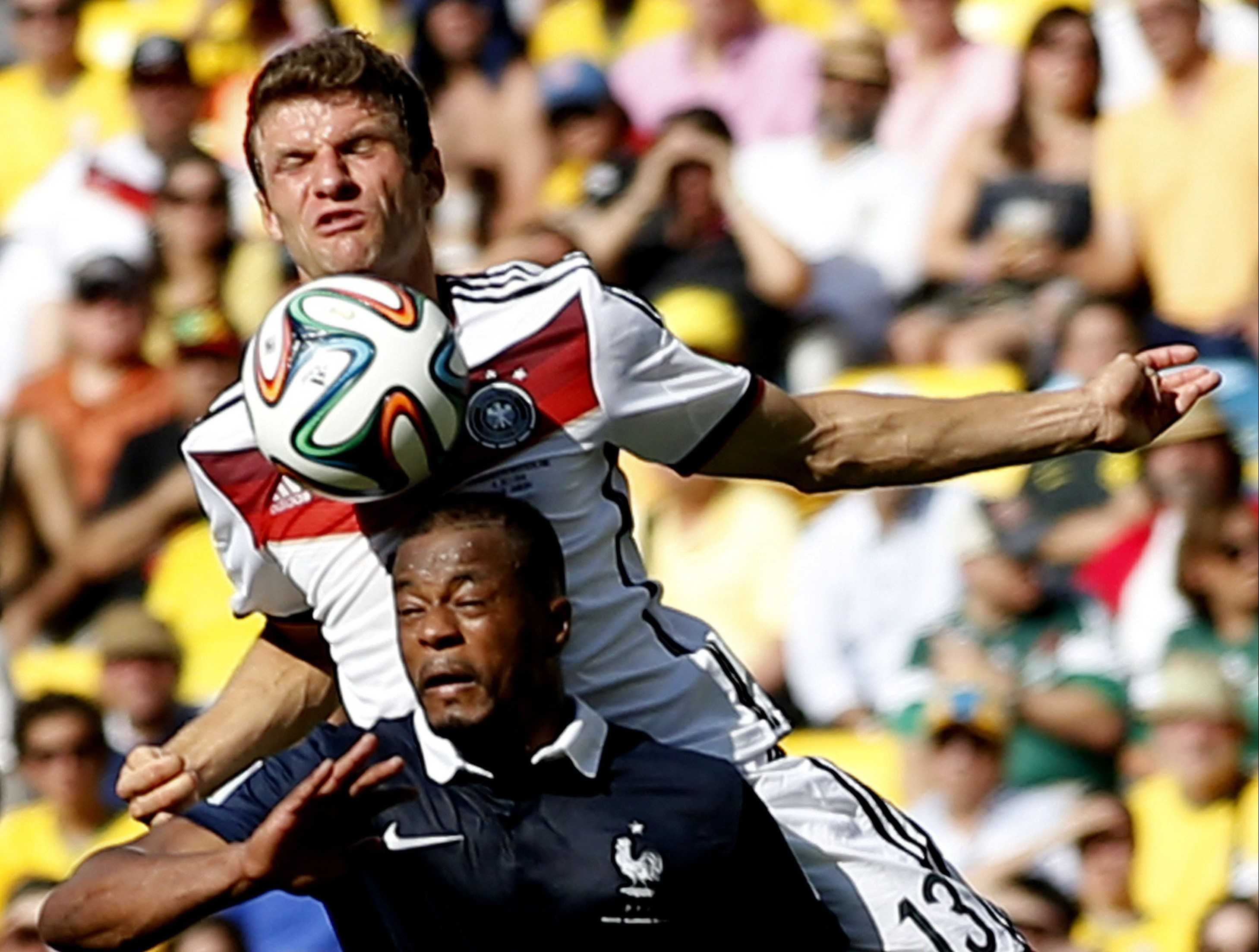 Germany's Thomas Muller vies with France's Patrice Evra (3) during a FIFA World Cup quarterfinal match at the Estadio do Maracana Stadium in Rio de Janeiro, Brazil. Germany advanced, 1-0. (Wang Lili/Xinhua/Zuma Press/MCT)