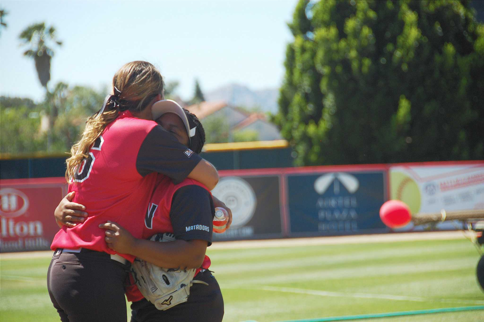 Pitchers+Brianna+Elder+%28left%29+and+Zoe+Conley+%28right%29+embrace+after+clinching+a+share+of+the+Big+West+Title+after+defeating+the+University+of+Hawai%27i+on+Saturday%2C+May+2.+Cladellain+David%2FPhoto+Editor