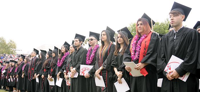 CSUN+seniors+stand+for+the+singing+of+the+national+anthem.