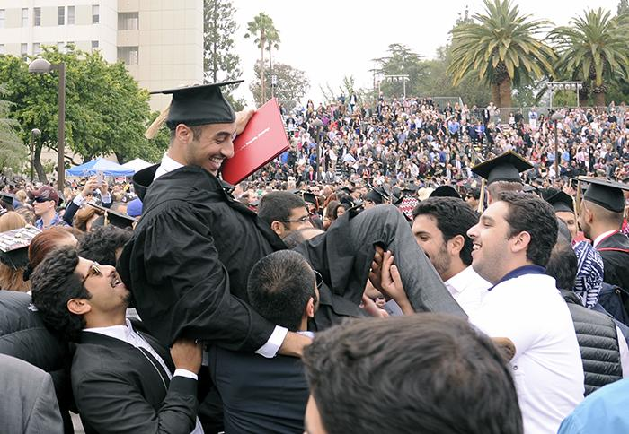 Friends pick up CSUN's recent alum from the Nazarian College of Business and Economics  in the 2015 graduation at Oviatt Lawn on Monday, May 18, 2015. (Raul Martinez / The Sundial)