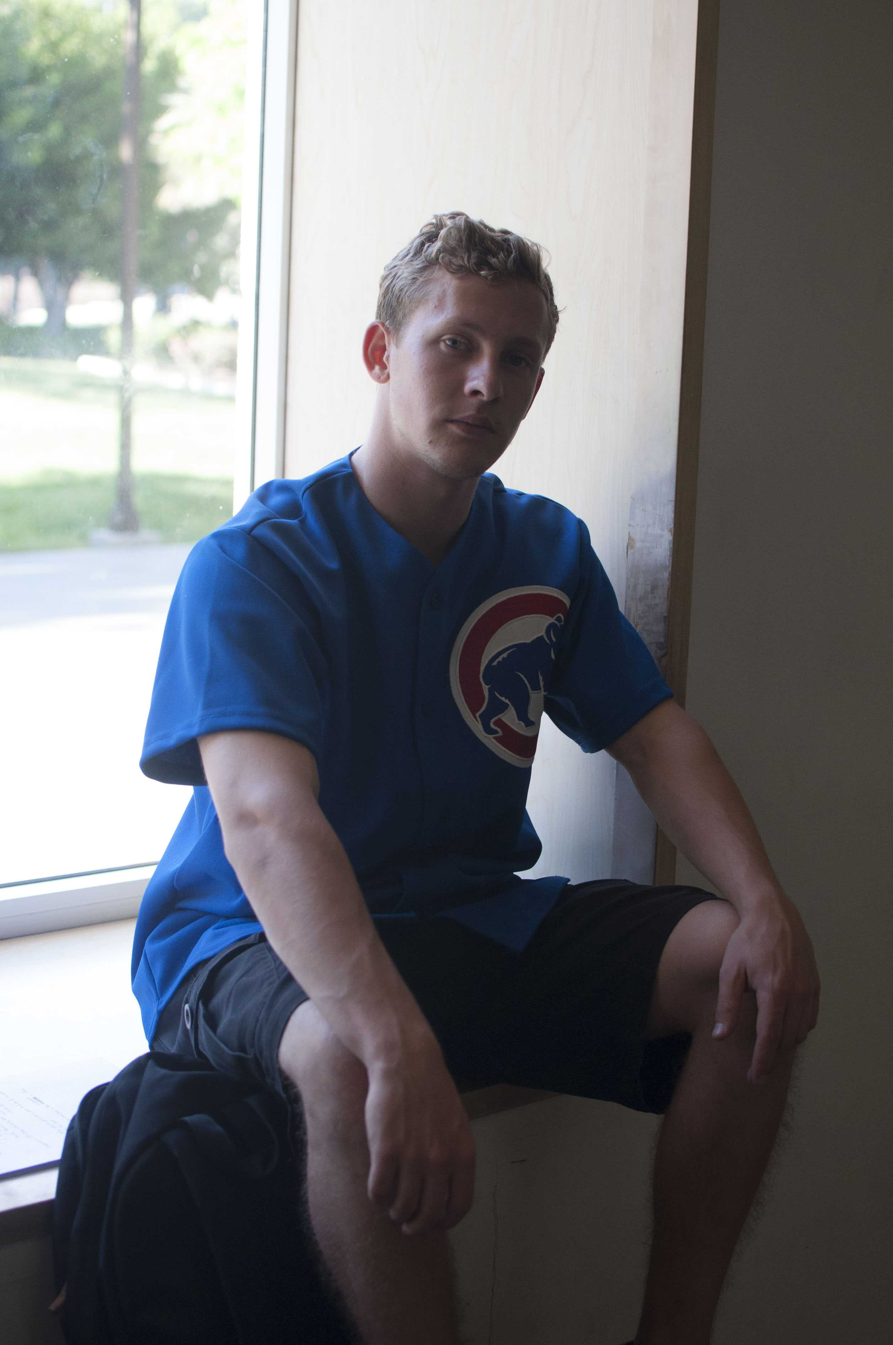 Max+Brichta%2C+junior+communication+studies%2C+sports+a+Chicago+Cubs+shirt%2C+a+gift+from+a+friend.+Brichta+says+he+wears+the+shirt+because+of+three+things.+%22One+-+acknowledge+the+gift%2C+acknowledge+the+giver.+Two+-+there%27s+no+name+so+I%27m+no+affiliating+it+with+anyone.+Three+-+blue+is+my+favorite+color.%22