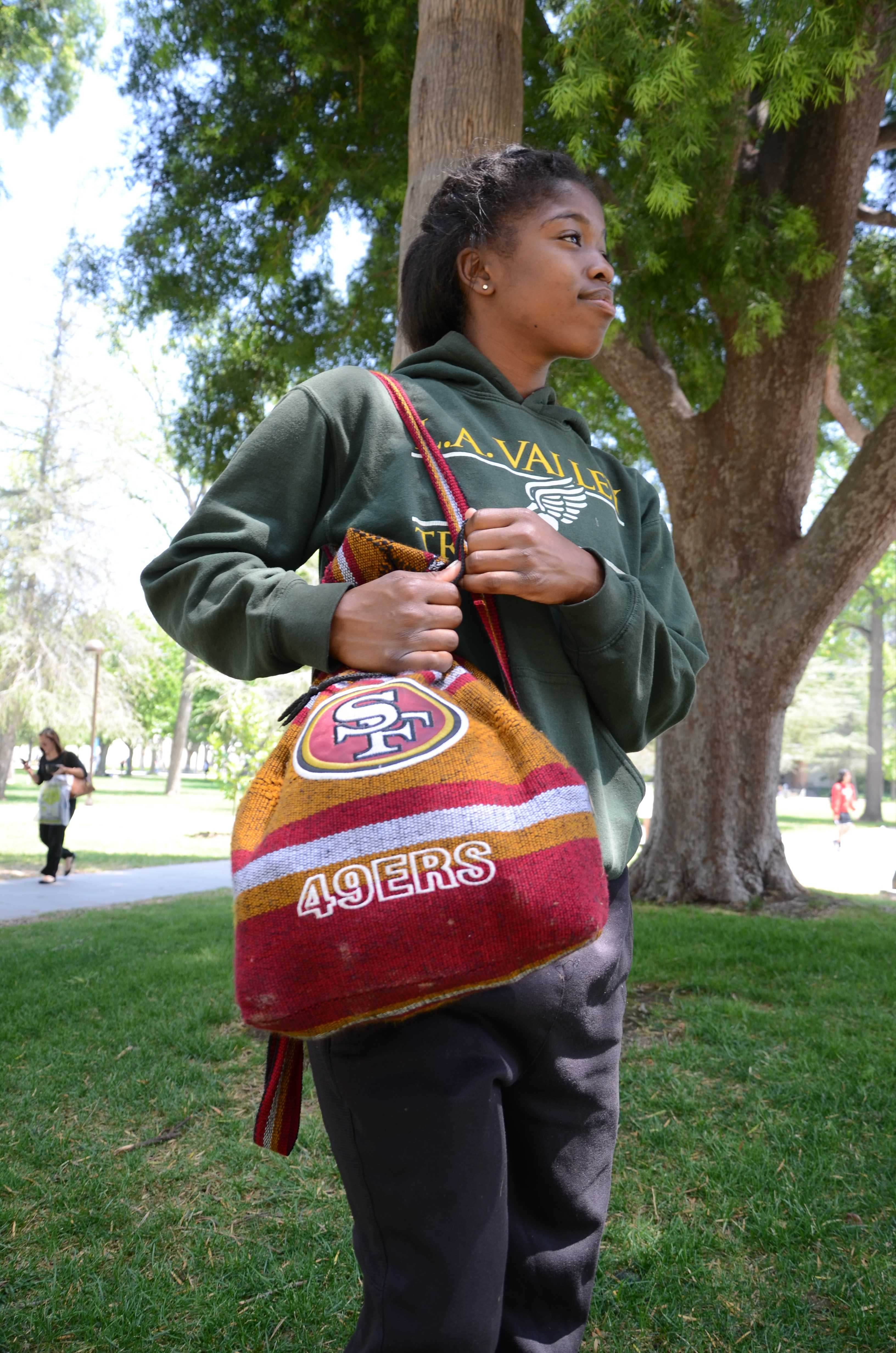 Upon+her+trip+to+Ensenada%2C+Mexico%2C+junior+kinesiology+major+Rhonda+Baker+stumbled+upon+a+shop+selling+bags+sporting+NFL+logos.+Baker+chose+the+49ers+bag+because+%22it+looked+fly%21%22