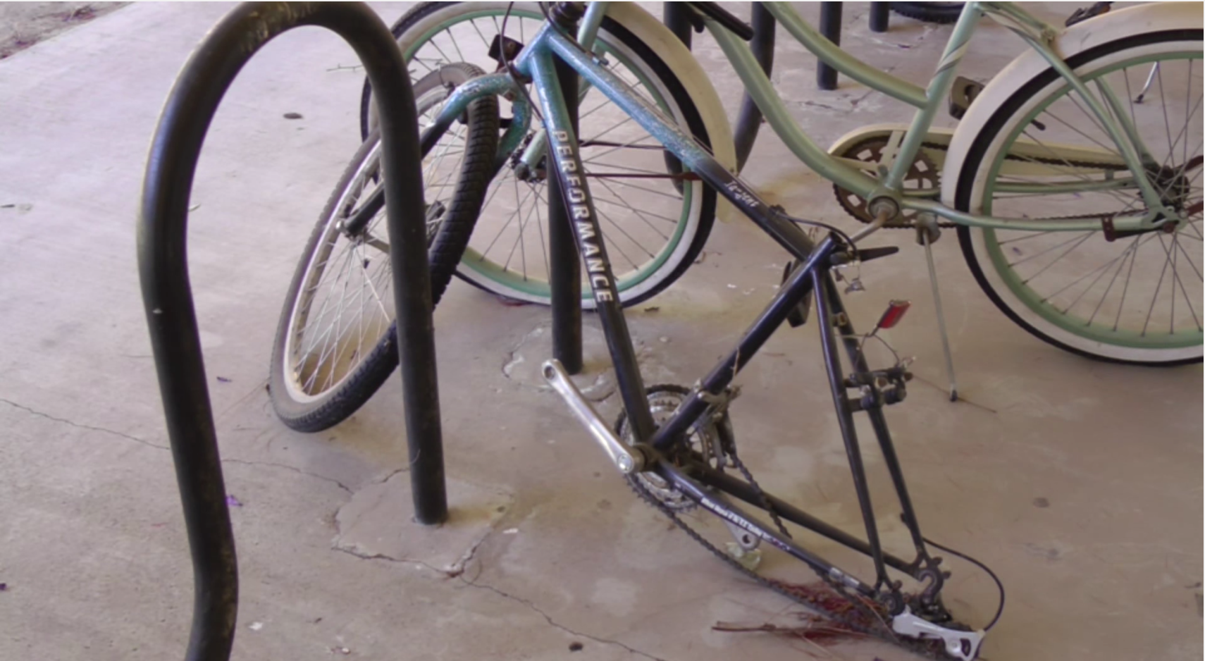 Several leftover, dismantled bicycles like this one clutter CSUN campus bike racks. Over 100 bicycle thefts were reported from Apr. 1, 2014 to the following year. Photo credit: Justen Gutierrez