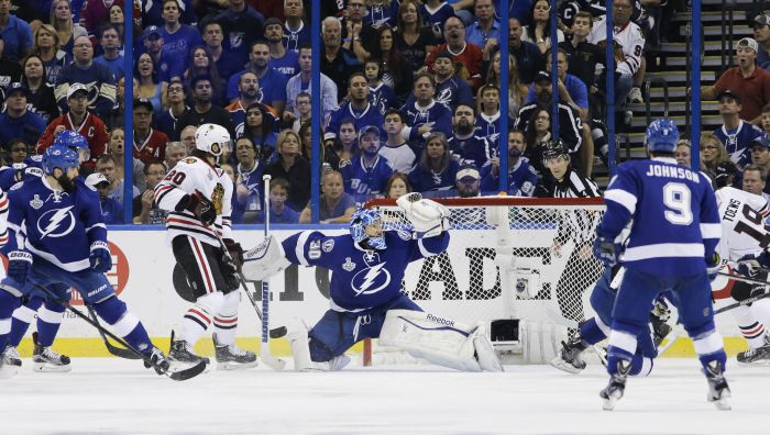 Tampa Bay Lightning goalie Ben Bishop, middle, makes a save on a shot by the Chicago Blackhawks