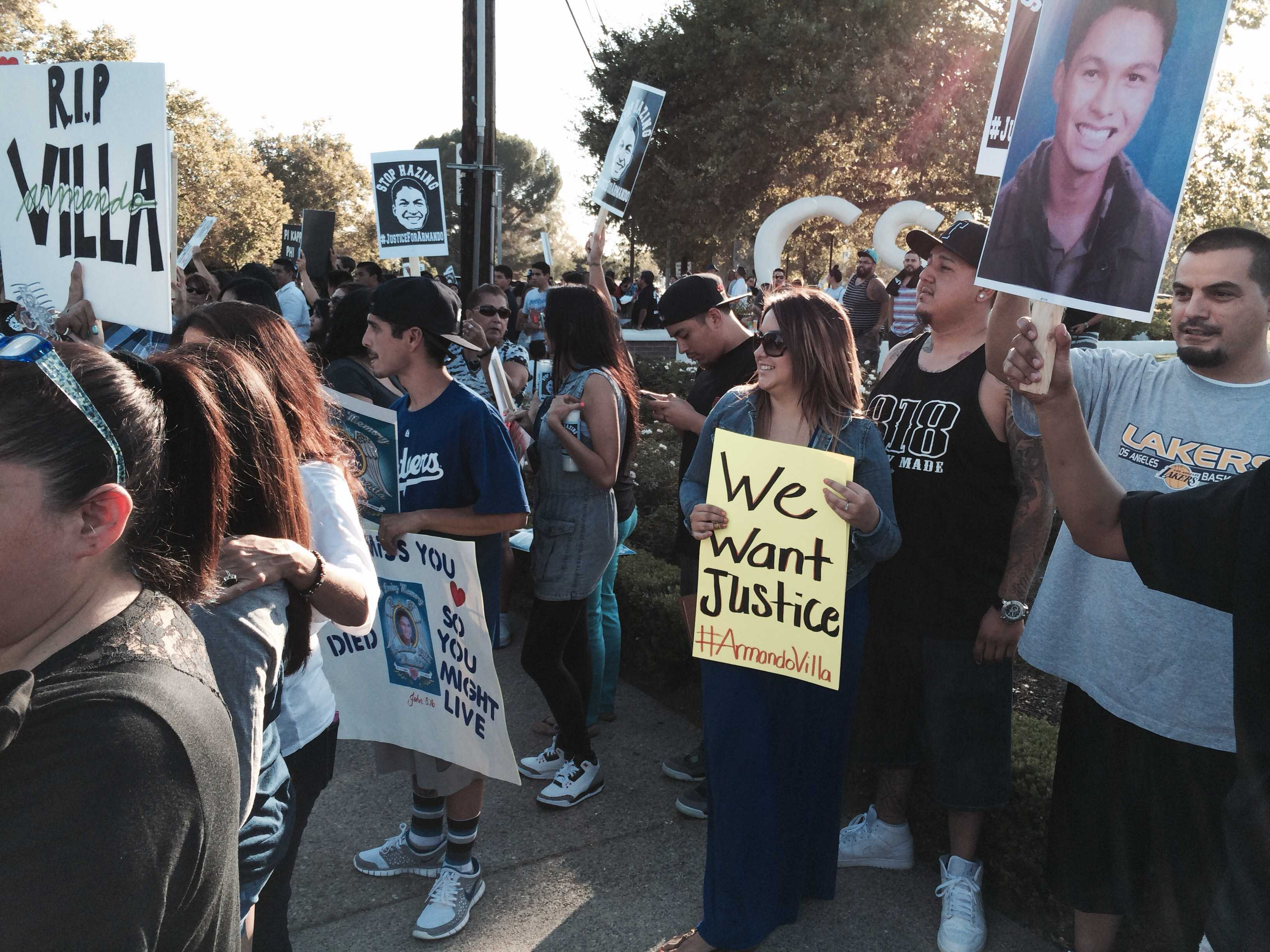 Family and CSUN students flooded the corners of Zelzah Avenue and Nordhoff Street in memory of CSUN student Armando Villa in July 2014. (Pete Camarillo / The Sundial)