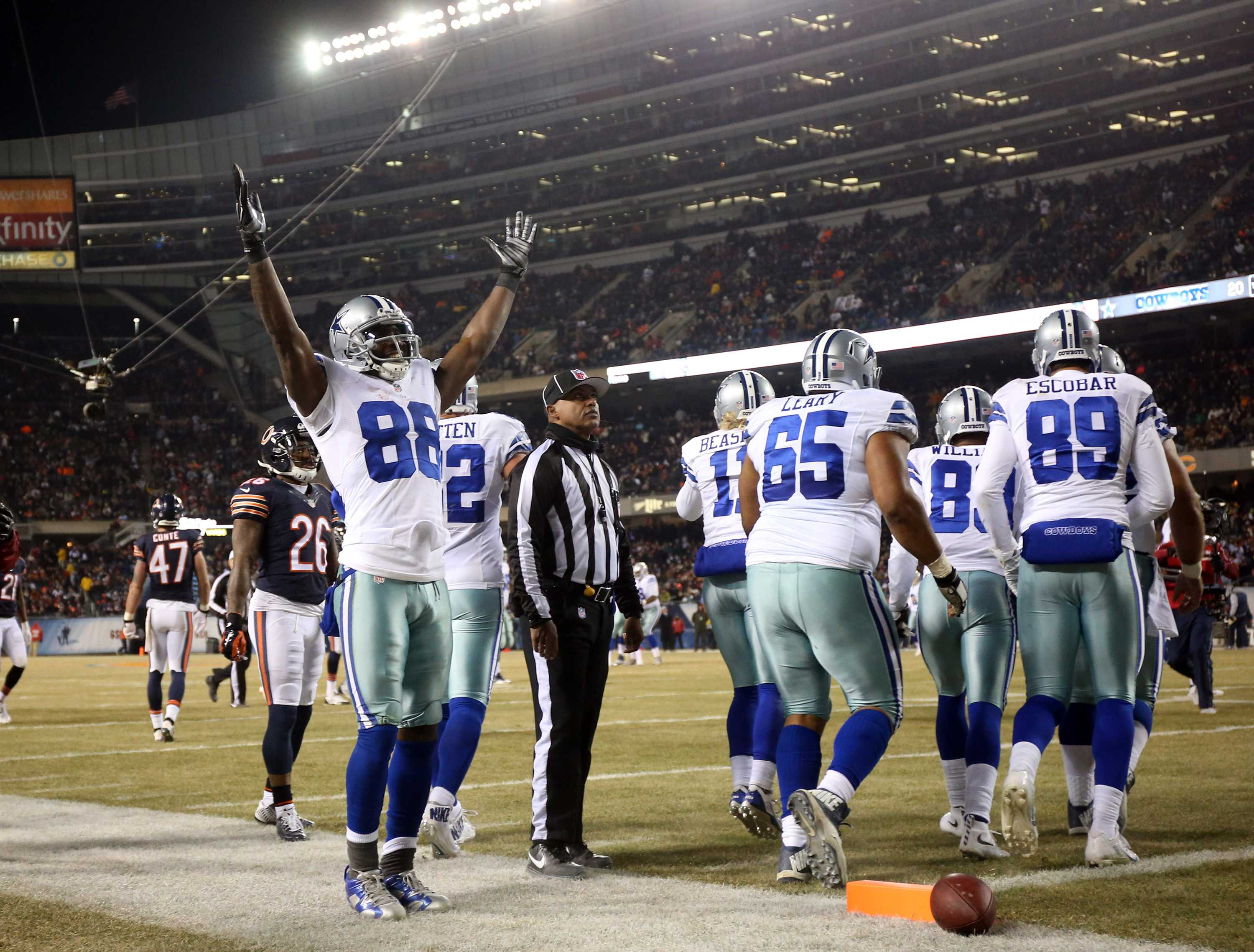 Dallas Cowboys wide receiver Dez Bryant (88) celebrates teammate Cole Beasley