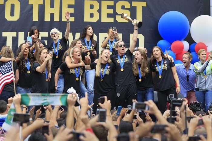 The U.S. women's soccer team celebrates after winning the FIFA Women's World Cup during a championship celebration on Tuesday, July 7, 2015, at L.A. Live's Microsoft Square in Los Angeles. (Allen J. Schaben/Los Angeles Times/TNS)