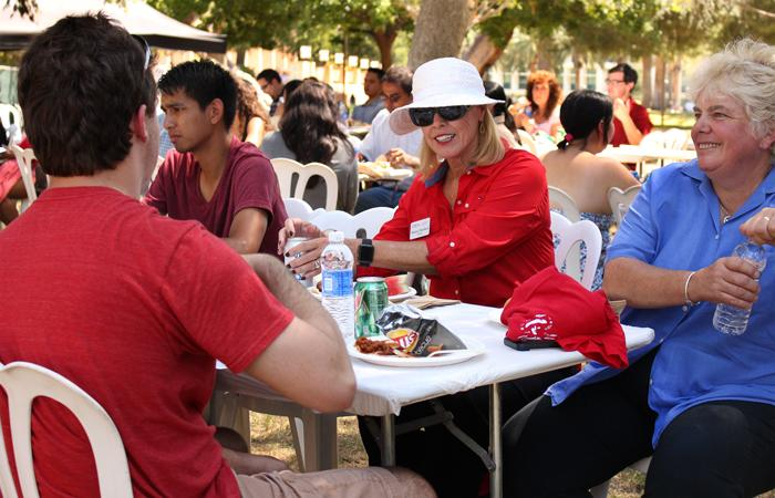 President Dianne F. Harrison eats with Campus Police Chief Anne P. Glavin and other students at the Picnic with the President event on Thursday, Aug. 27, 2015. (Halie Cook/ The Sundial)