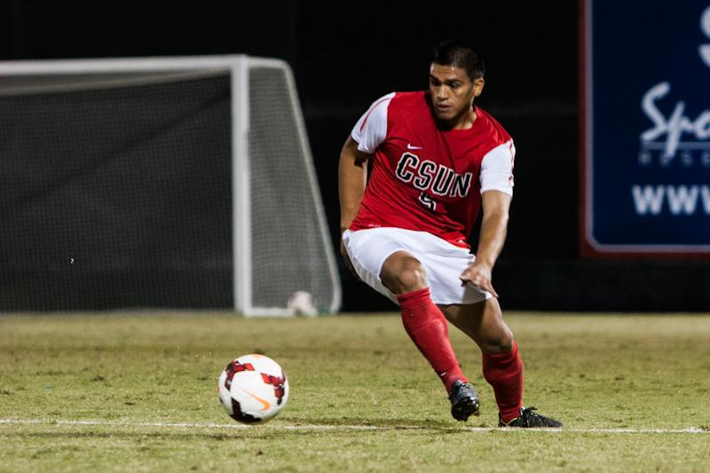 A CSUN soccer player rushes to retrieve the soccer ball. File Photo/The Sundial