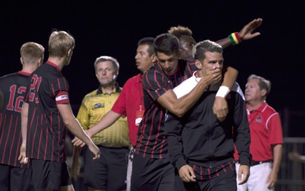Pol Schonhofer holds Steven Manios after the 1-0 overtime loss due to a penalty call against New Mexcio at Matador Soccer field. Christopher Linares / The Sundial