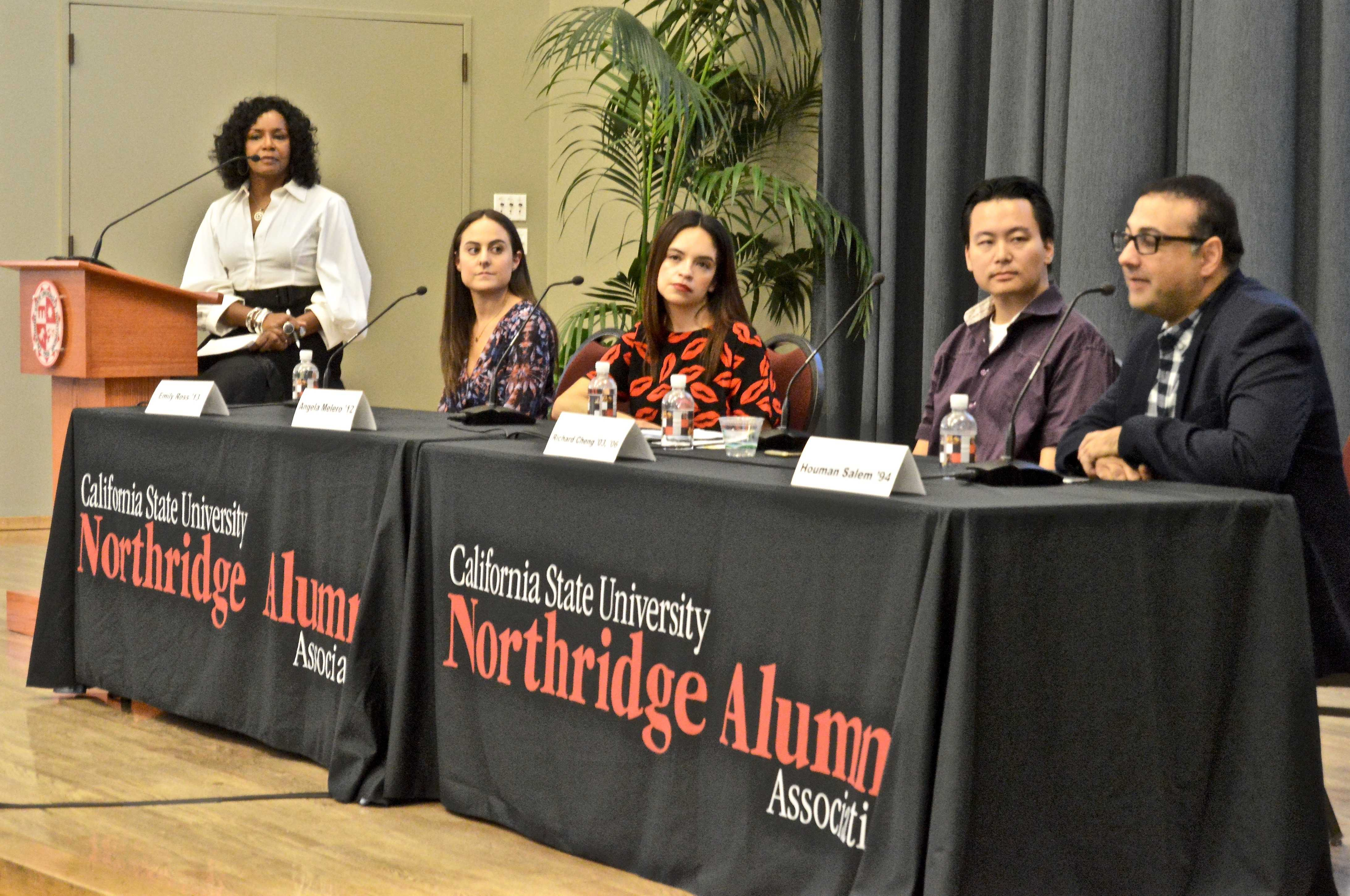 Fashion panelists spoke in front of CSUN student fashion designers, stylists and merchandisers.  Emily Ross (far left), Angela Melero, Richard Cheng and Houman Salem lectured in the Grand Salon. (Mariah Sherriffe / The Sundial)
