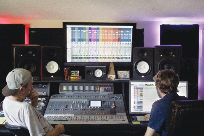 Riley Unverferth (left) and Robert Lynn (right) take advantage of their studio session near the CSUN campus in Northridge, Calif. on Monday, Aug. 17, 2015. Lynn is 23-year-old senior pursuing his passion while finishing up the CTVA program. Photo credit: Yocasta Arias