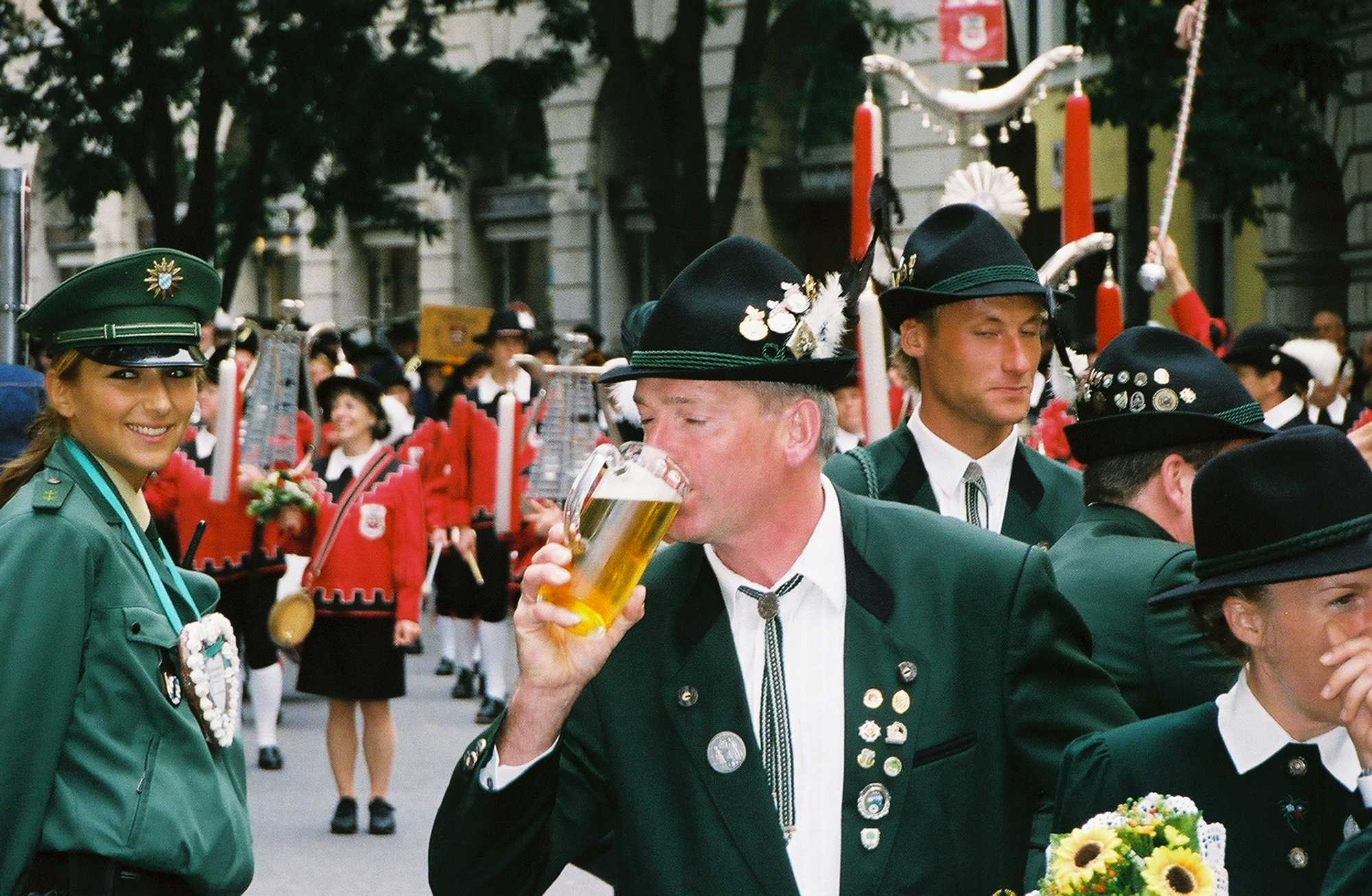 A+parade+marcher+quenches+his+thirst+while+a+policewoman+looks+on+during+the+Oktoberfest+parade+in+Munich%2C+Germany.+%28Thomas+Swick%2FSouth+Florida+Sun-Sentinel%2FMCT%29