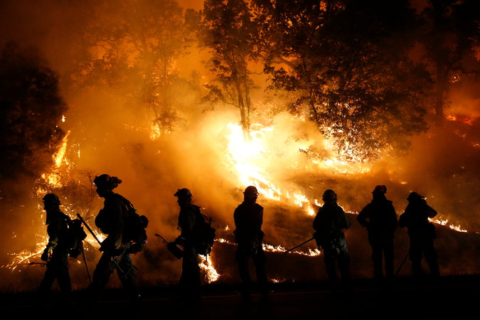 Firefighters+from+Marin+County+monitored+a+backfire+as+they+battled+the+Valley+Fire+this+month.++Firefighters+who+had+been+deployed+to+other+corners+of+the+state+scrambled+to+confront+the+blaze+as+it+grew+to+70%2C000+acres.+Credit+Stephen+Lam%2FGetty+Images