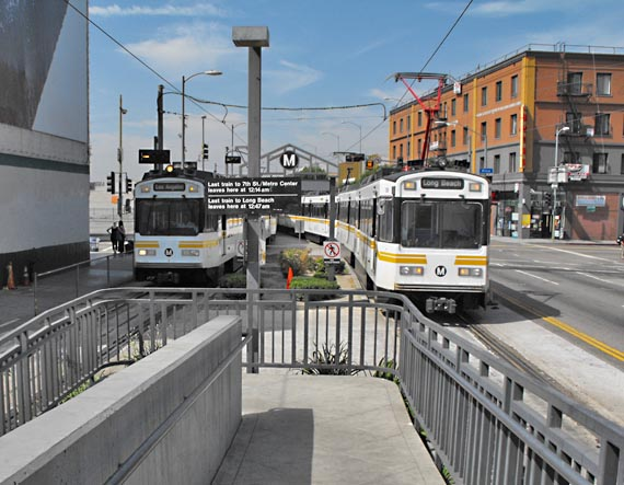 Two Metro trains approaching a stop.