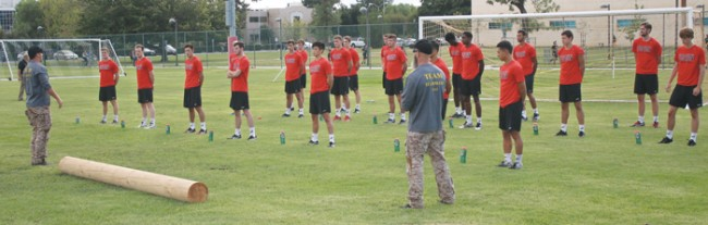 CSUN Mens Volleyball receives a pep talk from Acumen Performance Group trainers. (Leni Maiai / The Sundial)