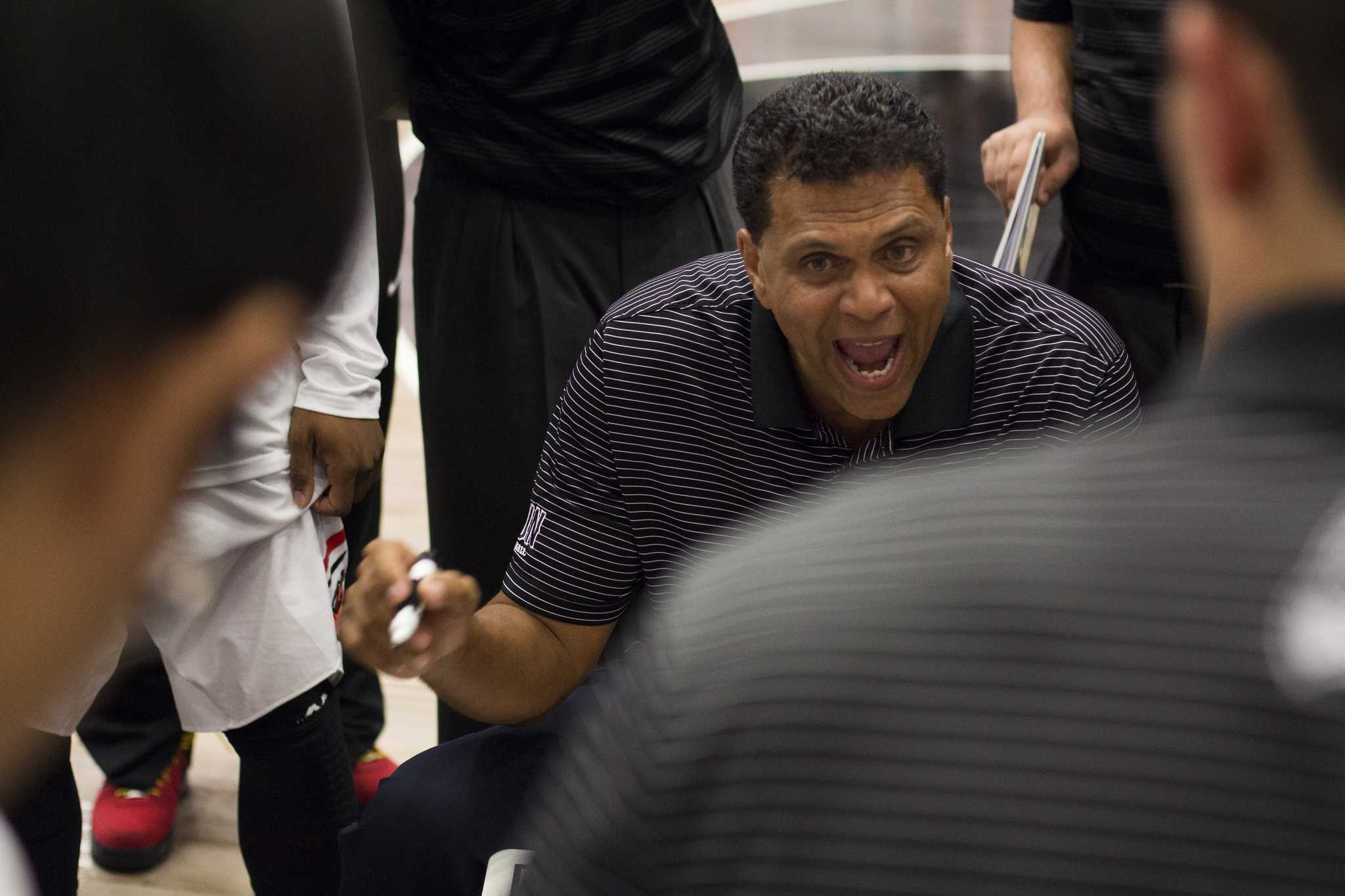 Reggie Theus coaching the basketball team at CSUN along side with his son, Reggis Theus Jr.