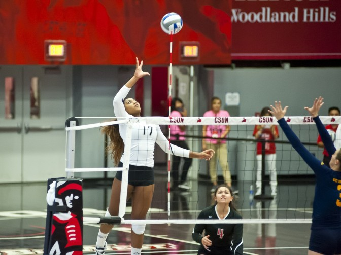 A+CSUN+student%2C+%28number+17%29+spike+the+volleyball+over+net+over+the+heads+of+the+team%27s+opponents.