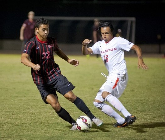 Freshman midfielder Andrew Rizeq dribbles past a Cal State Fullerton defender. The Matadors will look to stay alive in the Big West against the UC Riverside Highlanders. Photo credit: David Hawkins