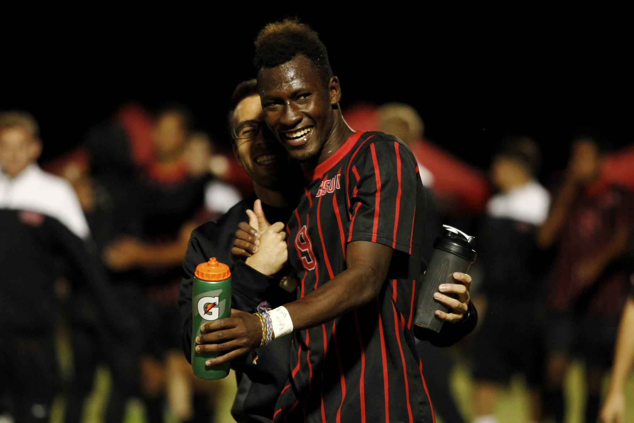 Sophomore+forward+Papi+Diouf+celebrates+with+a+member+of+the+CSUN+staff+after+scoring+the+game-winning+goal+against+UC+Riverside.+%28Juan+Pardo%29