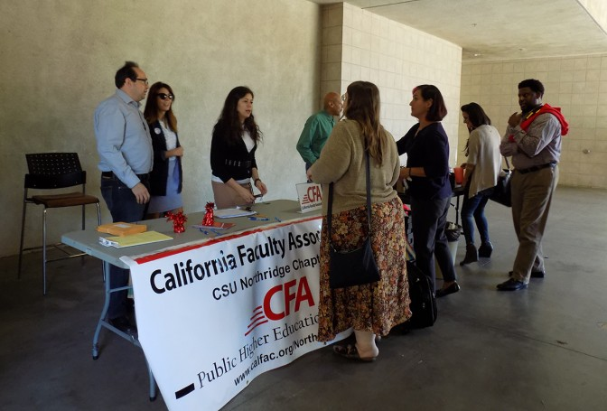 Members+of+the+CFA+help+sign+up+faculty+at+Sierra+tower+to+participate+in+a+vote+to+strike+this+Oct.+21.+Photo+credit%3A+Nicollette+Ashtiani
