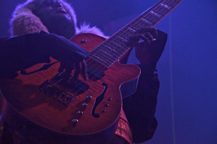 Thundercat playing his guitar.
