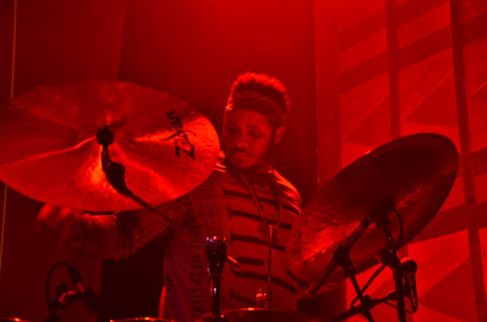 The drummer that plays for Thundercat checks his equipment