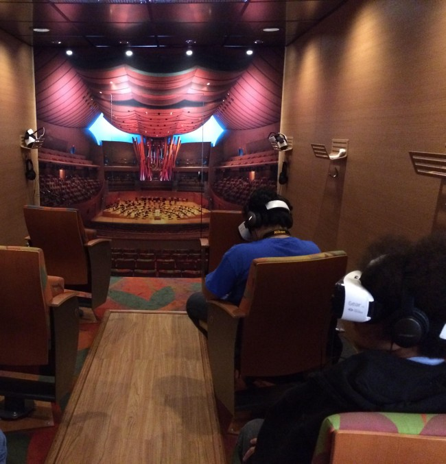 Inside the Van Beethoven truck, students with their Oculus head gear watch Gustavo Dudamel conduct the orchestra.