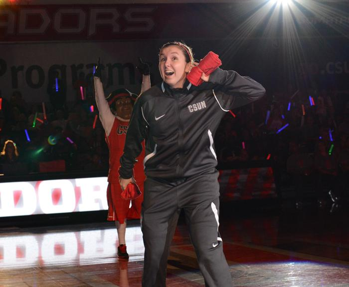 Emily Cole of the Women's CSUN's Basketball team, excites the crowd to prepare for Matador Madness on Friday.