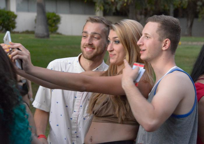 Three CSUN pose for a selfie while waiting in line to enter Big Show.