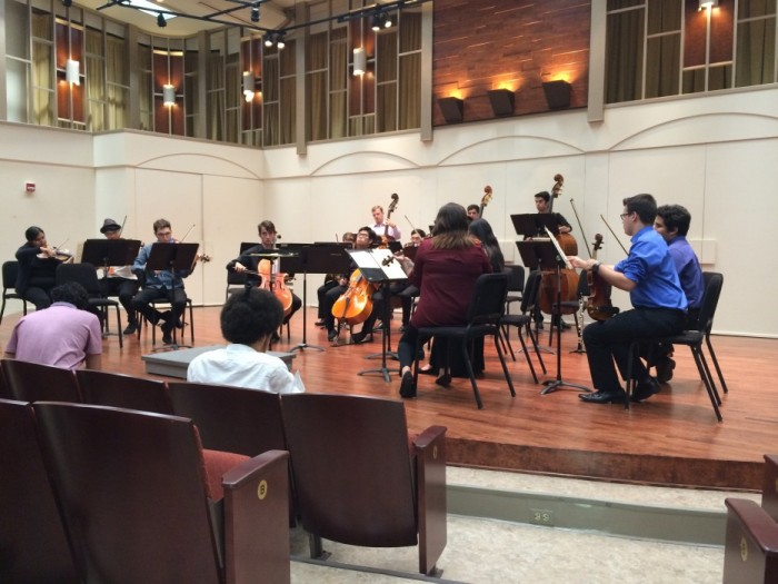 The CSUN Symphony Chamber Orchestra warms up and tunes as they get ready to start their concert Thursday night. Photo credit: Breanne Foster