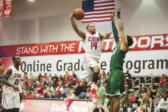 CSUN guard Aaron Parks drives to the basket in a 2015 game against Hawaii.